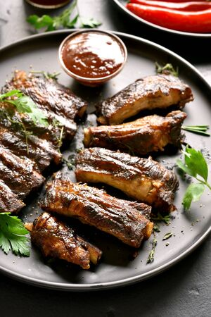 Barbecue spare ribs on plate. Tasty grilled meat.