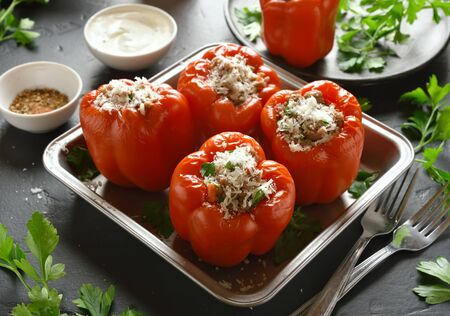 Stuffed red peppers with minced meat, rice, onion, parmesan cheese