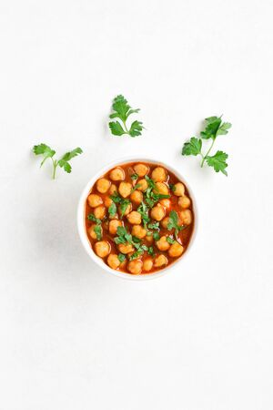 Indian style roasted chickpeas in bowl over white background with free text space. Vegetarian vegan food concept. Top view, flat lay Reklamní fotografie