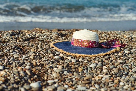 Woman hat on the beach. Selective focus.