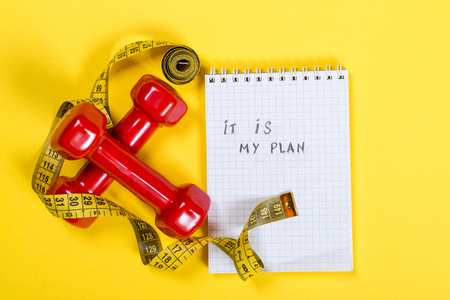 Red dumbbells and measuring tape and text , it is my plan, on paper. Healthy lifestyle concept.