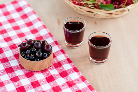 Homemade liqueur made from a black currants and red gooseberry.