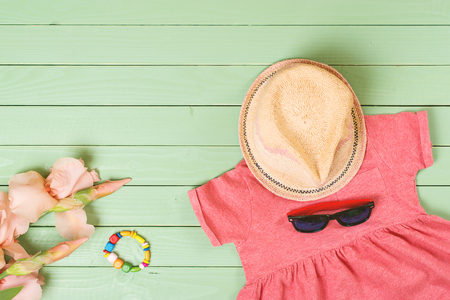 outerwear: set of baby girls clothes on the wooden background