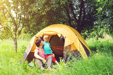 pitching: Happy father and son at the camping in summer. Toned. Stock Photo