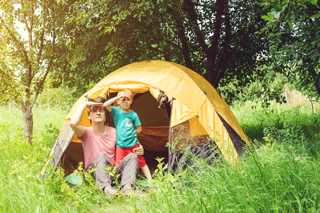 Happy father and son at the camping in summer. Toned. Stock Photo