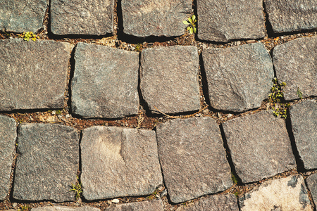 Old cobblestoned pavement background close up