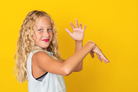 Handsome young girl posing on the yellow background. 写真素材