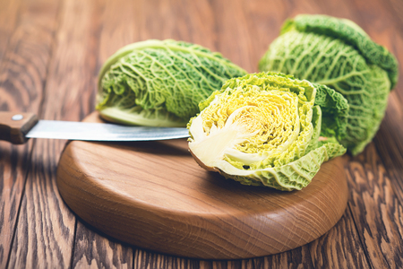 savoy cabbage from organic grower farm, on the wooden plate Stock Photo
