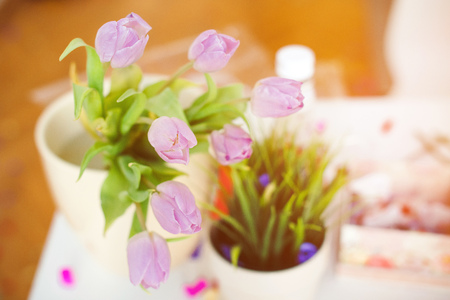 Pink tulips in a vase on a kitchen table. Good beginning of the day. Morning mood. Spring concept. Sunny spring morning with flowers