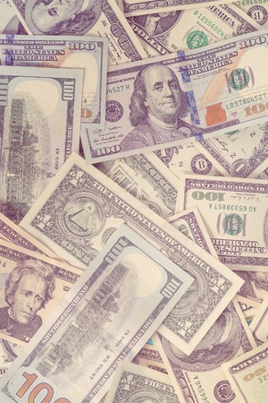 Dollar banknotes background, top view. One hundred dollars and one dollars bill. Business concept. Close up view of cash money dollars bills