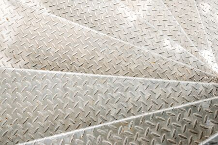 Non-slip steel stairs. Metal textured surface. Metallic checker plate anti-slip texture background. Metal old background.