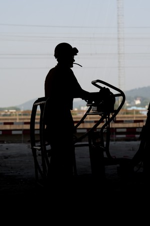 silhouette of worker on building site photo