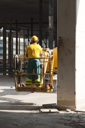 Worker on building site photo
