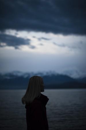 joyless: woman alone on lake