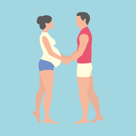 pregnant woman and her husband holding hands on blue background