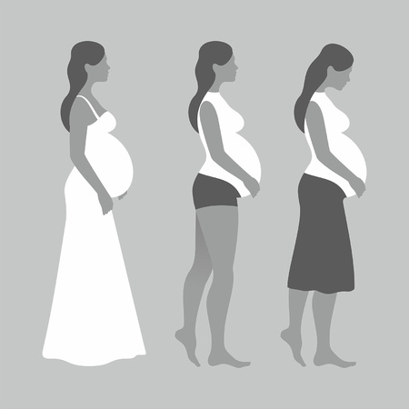 Pregnant woman on gray background