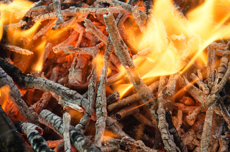 smoldering: hot coals from the burnt wood
