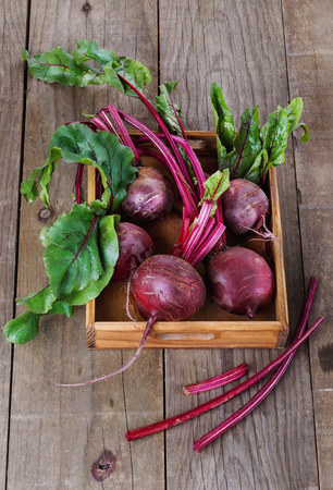 Organic beetroot in a wooden box over rustic wooden background Banco de Imagens