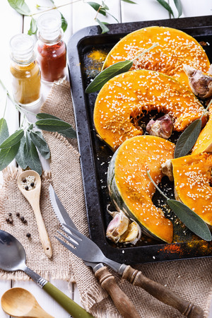 sesame seed: Cooking pumpkin with garlic, sage, sesame seed and spices. Close up image