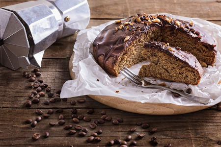 coffee cake: Coffee cake, moka pot, cup of coffee and coffee beans on rustic wooden background Stock Photo