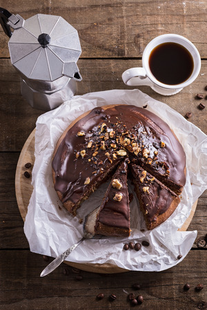 holiday maker: Chocolate cake and coffee on dark wooden background