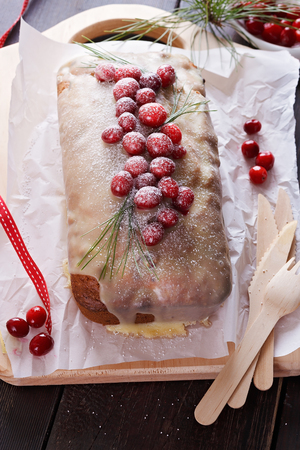 pound cake: Pound cake with fresh cranberries over rustic wooden background