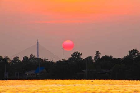 Sundown at the Chaopraya river. photo