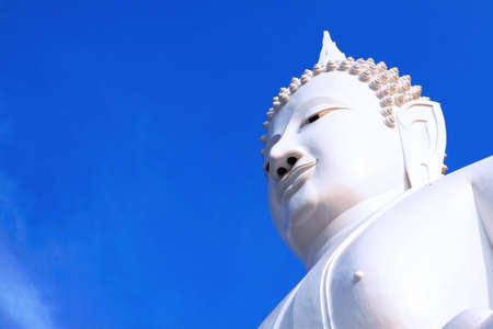 Blue sky and white enormous buddha photo
