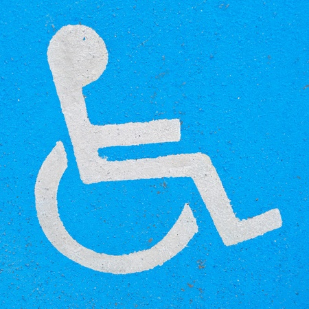 Handicapped sign, icon or logo painted on asphalt Stock Photo - 9722514