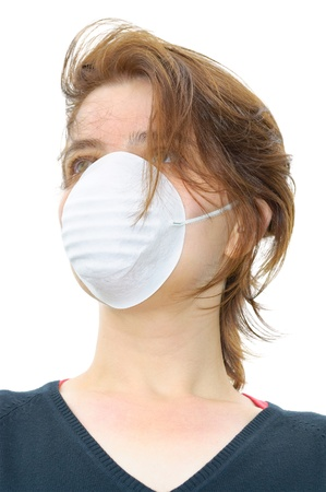Woman wears protective mask against flu or pollution