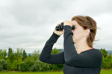 Woman with binoculars Stock Photo - 10596581