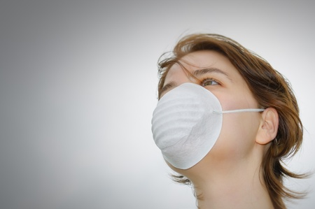 swine flu: Woman with medical mask and copy space Stock Photo