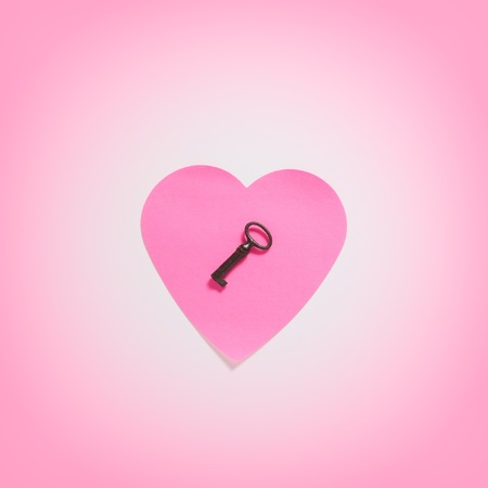 Paper heart with key in pink fog photo