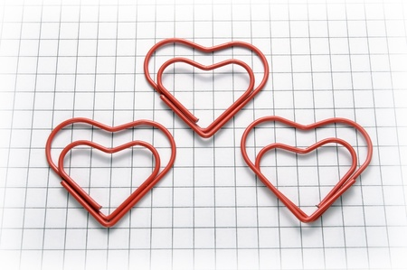 copybook: Closeup of heart shaped red paper clips Stock Photo