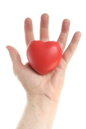 hipertension: Corazón rojo en el hombre Foto de archivo