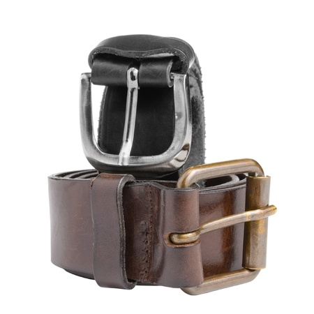 Black and brown leather belts isolated on white background