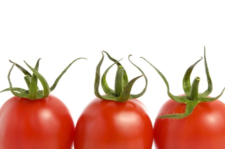 Three fresh tomatoes isolated on white background Stock Photo - 14133323