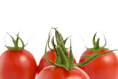 Four fresh tomatoes isolated on white background Stock Photo - 14133325
