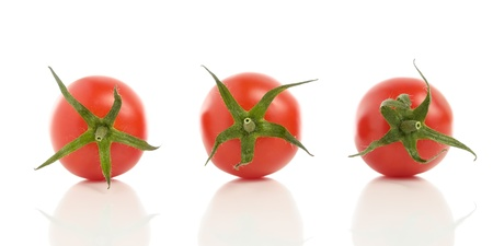 Three tomatoes with reflection isolated on white background Stock Photo - 14291717