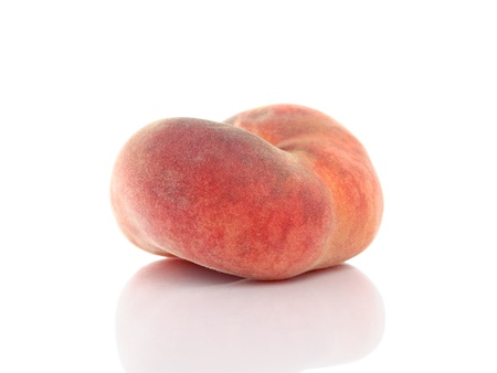 Flat saturn or donut peach with reflection isolated on white background photo
