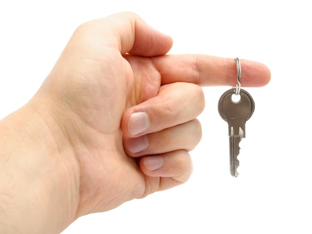 Hand holding the key of a new home isolated on white background Stock Photo - 14809398