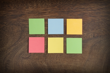 Six colorful sticky notes on wooden background Stock Photo - 14871754