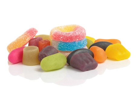 Several various colorful sweets on white background