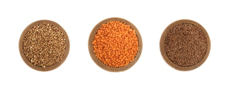 Buckwheat, red lentils and flax seeds on wooden plate isolated on white background Stock Photo - 15634901