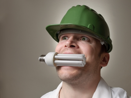 Environmental engineer with a lightbulb in his mouth photo