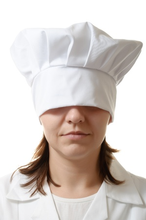 Chef woman hiding her eyes under her hat photo