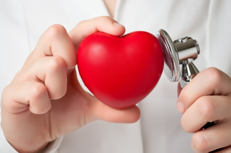 cure prevention: Doctor examining a heart