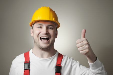maintenance fitter: Smiling young repairman with yellow hard hat