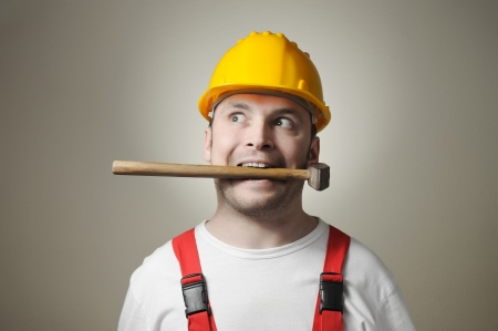 Crazy young handyman with hammer Stock Photo