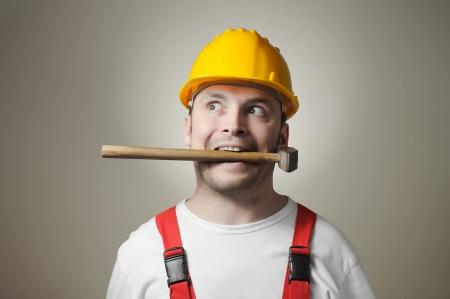 Crazy young handyman with hammer Standard-Bild